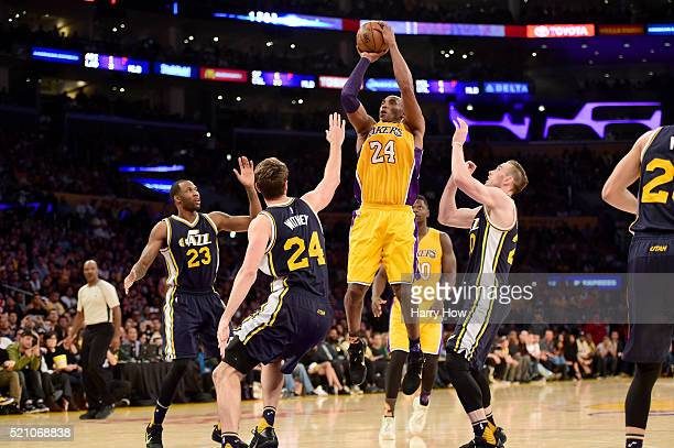Kobe Bryant of the Los Angeles Lakers goes up for a shot against Jeff Withey of the Utah Jazz in the fourth quarter at Staples Center on April 13,...