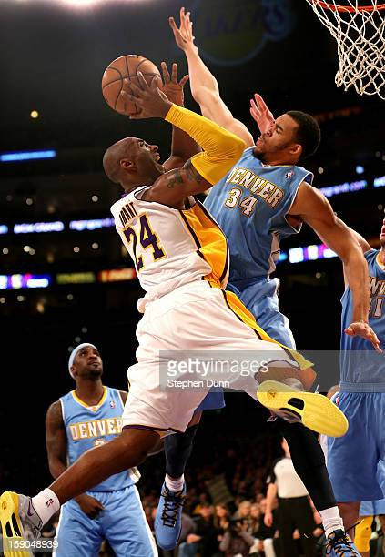 Kobe Bryant of the Los Angeles Lakers goes up for a shot against JaVale McGee of the Denver Nuggets at Staples Center on January 6 2013 in Los...