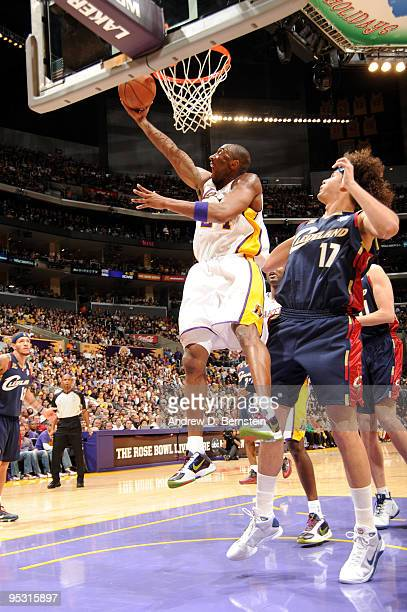 Kobe Bryant of the Los Angeles Lakers goes up for a shot against Anderson Varejao of the Cleveland Cavaliers at Staples Center on December 25 2009 in...