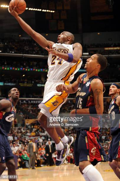 Kobe Bryant of the Los Angeles Lakers goes up for a shot against Jamario Moon of the Cleveland Cavaliers at Staples Center on December 25 2009 in Los...