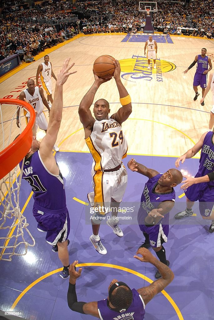 Kobe Bryant #24 of the Los Angeles Lakers goes up for a shot against Spencer Hawes #31 and Bobby Jackson #24 of the Sacramento Kings during the game at Staples Center on November 23, 2008 in Los Angeles, California. The Lakers won 118-108.