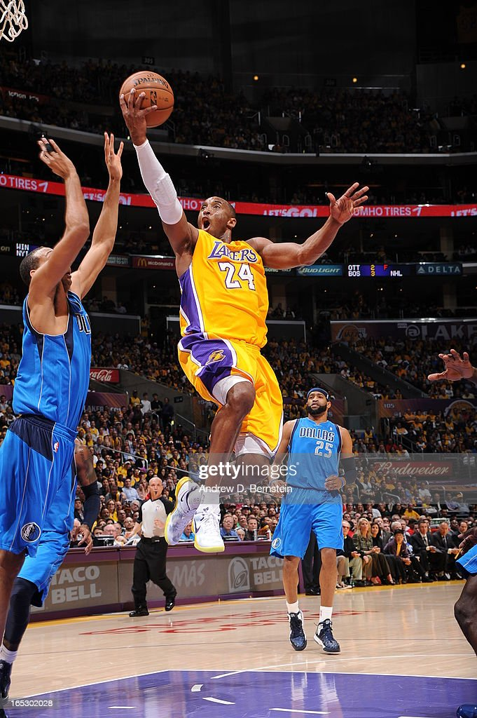 Kobe Bryant #24 of the Los Angeles Lakers goes up for a shot against the Dallas Mavericks at Staples Center on April 2, 2013 in Los Angeles, California.