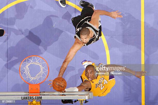 Kobe Bryant of the Los Angeles Lakers goes up for a shot against Tim Duncan of the San Antonio Spurs in Game Five of the Western Conference Finals...