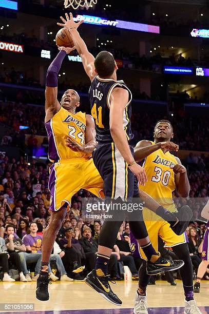 Kobe Bryant of the Los Angeles Lakers goes up for a shot against Trey Lyles of the Utah Jazz in the third quarter at Staples Center on April 13, 2016...