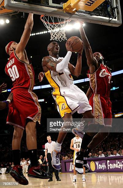 Kobe Bryant of the Los Angeles Lakers goes up for a shot between Drew Gooden and LeBron James of the Cleveland Cavaliers at Staples Center January 27...