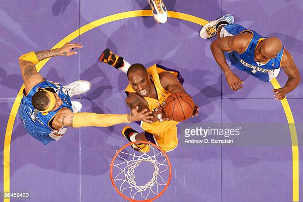 Kobe Bryant of the Los Angeles Lakers goes up for a shot between Kenyon Martin and Chauncey Billups of the Denver Nuggets at Staples Center on...