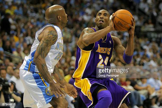 Kobe Bryant of the Los Angeles Lakers goes up for a shot over Anthony Carter of the Denver Nuggets in the second quarter of Game Three of the Western...