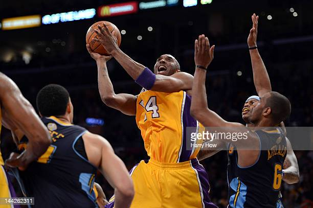 Kobe Bryant of the Los Angeles Lakers goes up for a shot over Arron Afflalo of the Denver Nuggets in the first half in Game Seven of the Western...