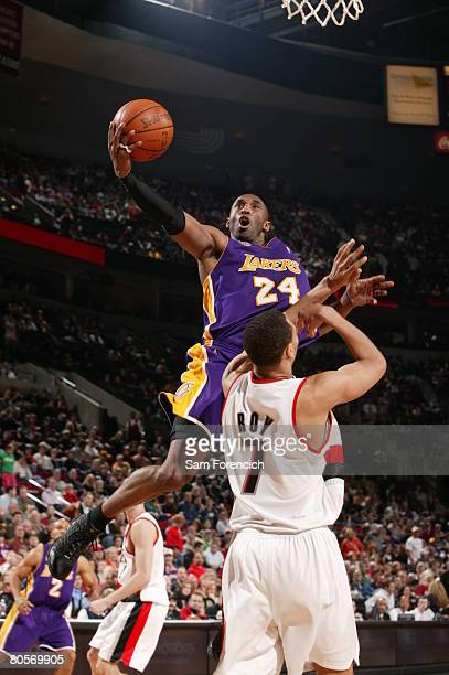 Kobe Bryant of the Los Angeles Lakers goes up for a shot over Brandon Roy of the Portland Trail Blazers during a game on April 8 2008 at the Rose...