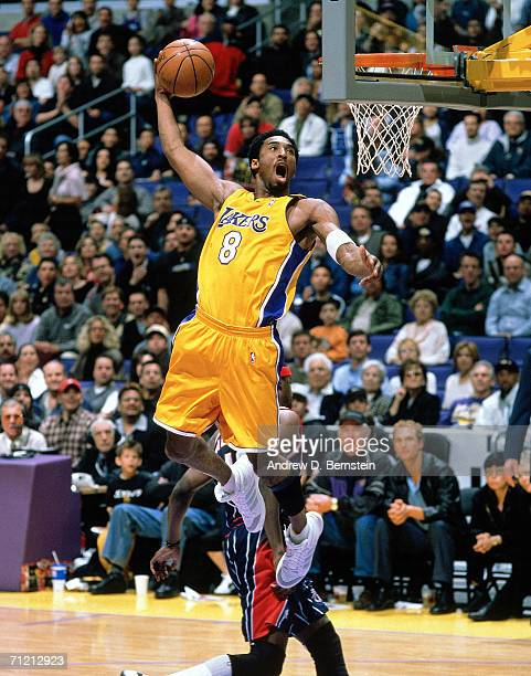 Kobe Bryant of the Los Angeles Lakers goes up for a slam dunk against the Houston Rockets during a game at Staples Center in Los Angeles, California....