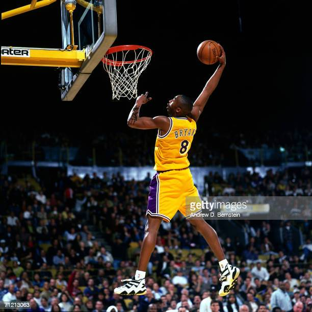 Kobe Bryant of the Los Angeles Lakers goes up for a slam dunk during a 1997 NBA game at The Great Western Forum in Inglewood, California. NOTE TO...