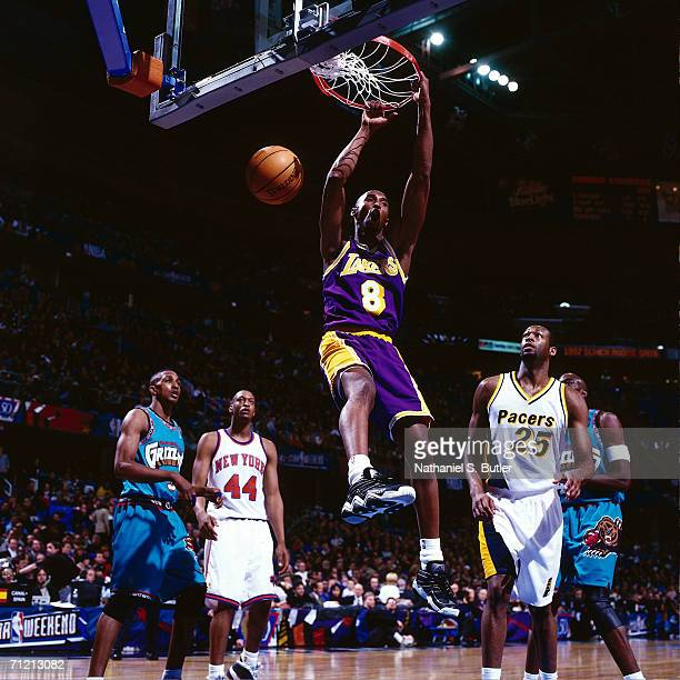 Kobe Bryant of the Los Angeles Lakers goes up for a slam dunk in the All-Star Rookie Game during the 1997 NBA All-Star Week at Gund Arena in...