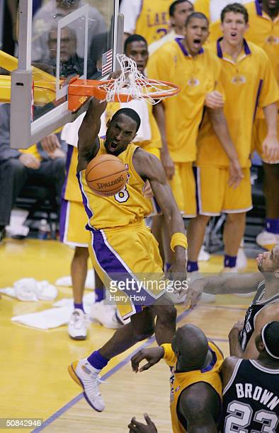Kobe Bryant of the Los Angeles Lakers goes up for a slam dunk over Tim Duncan of the San Antonio Spurs during Game six of the Western Conference...
