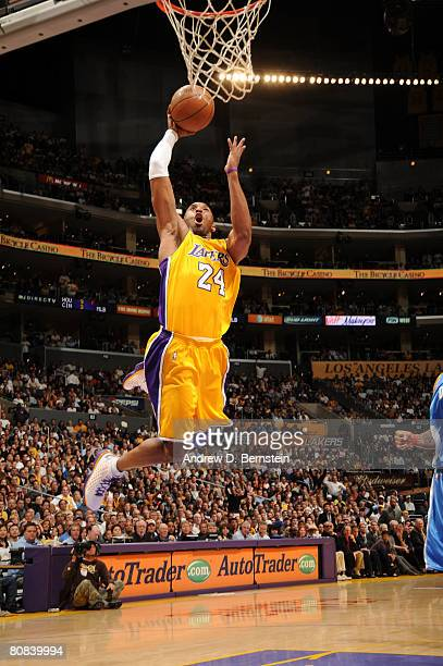 Kobe Bryant of the Los Angeles Lakers goes up for an uncontested dunk in Game Two of the Western Conference Quarterfinals against the Denver Nuggets...