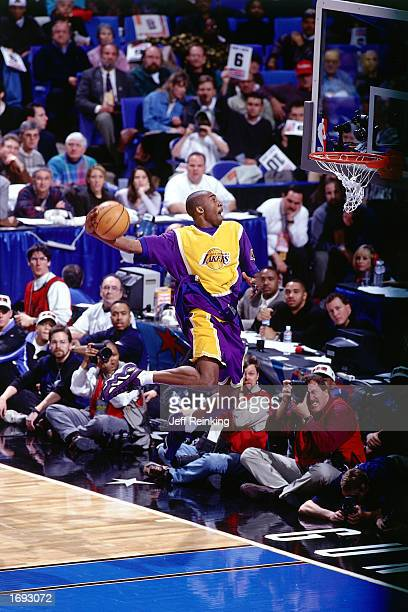 Kobe Bryant of the Los Angeles Lakers goes up for one of his slam dunks that won first place in the NBA All-Star Slam Dunk Contest at Gund Arena on...