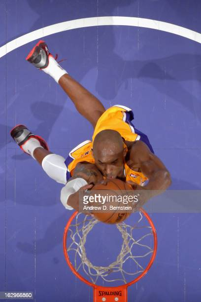 Kobe Bryant of the Los Angeles Lakers goes up for the dunk against the Los Angeles Clippers at Staples Center on February 14 2013 in Los Angeles...