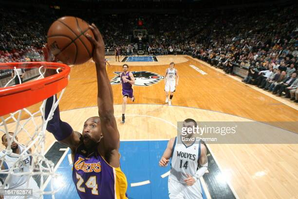 Kobe Bryant of the Los Angeles Lakers goes up for the dunk against the Minnesota Timberwolves during the game on March 27 2013 at Target Center in...