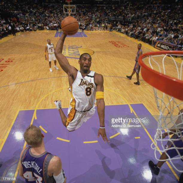 Kobe Bryant of the Los Angeles Lakers goes up for the dunk during the game against the Phoenix Suns at Staples Center on January 5, 2003 in Los...