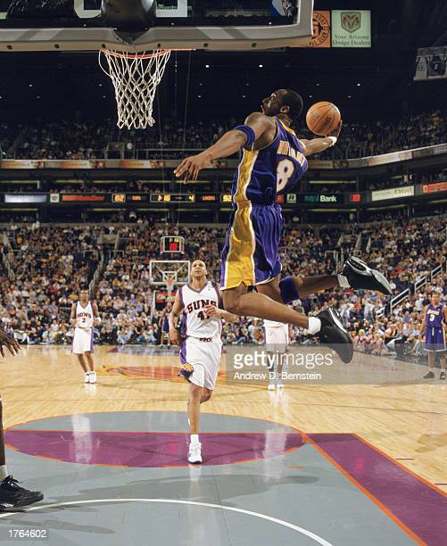Kobe Bryant of the Los Angeles Lakers goes up for the dunk during the game against the Phoenix Suns at America West Arena on January 29 2003 in...