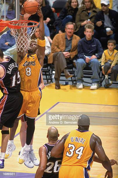 Kobe Bryant of the Los Angeles Lakers goes up for the dunk over Matt Harpring of the Utah Jazz during the game at Staples Center on December 8, 2002...