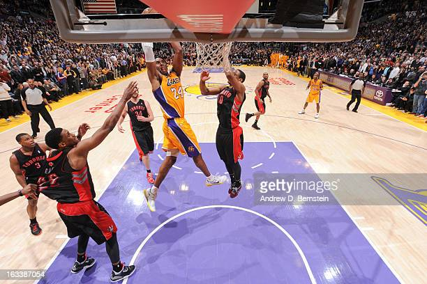 Kobe Bryant of the Los Angeles Lakers goes up for the goahead dunk in overtime against DeMar DeRozan of the Toronto Raptors at Staples Center on...