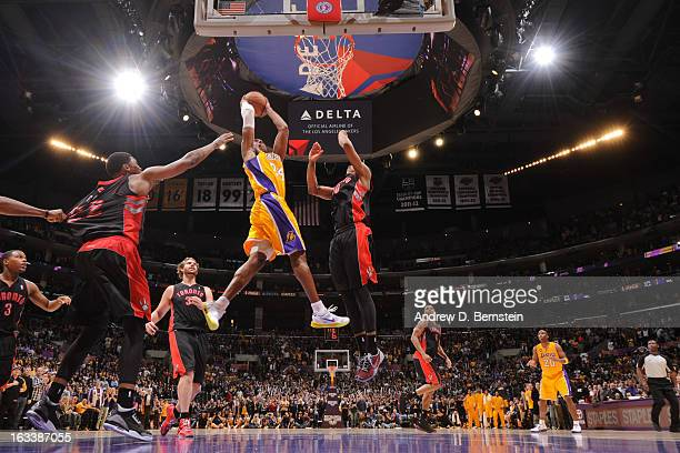 Kobe Bryant of the Los Angeles Lakers goes up for the go-ahead dunk in overtime against DeMar DeRozan of the Toronto Raptors at Staples Center on...