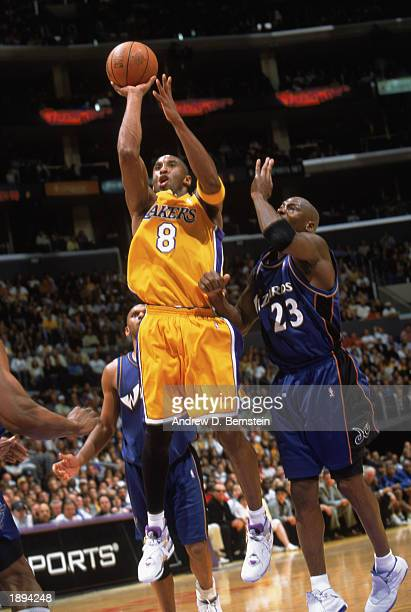 Kobe Bryant of the Los Angeles Lakers goes up for the shot against Michael Jordan of the Washington Wizards during the game at Staples Center on...