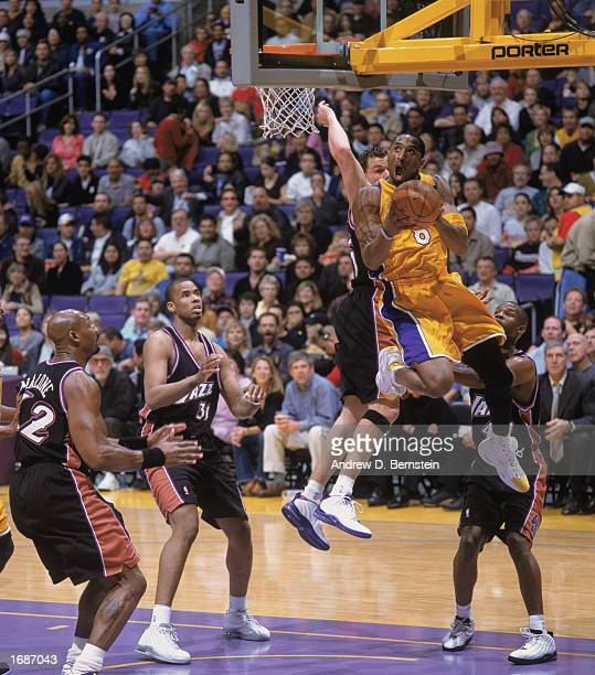 Kobe Bryant of the Los Angeles Lakers goes up for the shot during the game against the Utah Jazz at Staples Center on December 8, 2002 in Los...