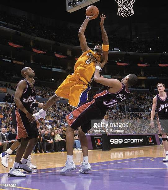 Kobe Bryant of the Los Angeles Lakers goes up for the shot over Jarron Collins of the Utah Jazz during the game at Staples Center on December 8, 2002...