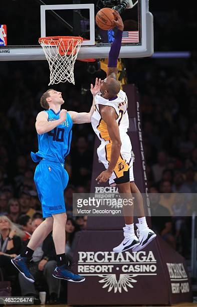 Kobe Bryant of the Los Angeles Lakers goes up for the slam dunk against Cody Zeller of the Charlotte Hornets during the NBA game at Staples Center on...