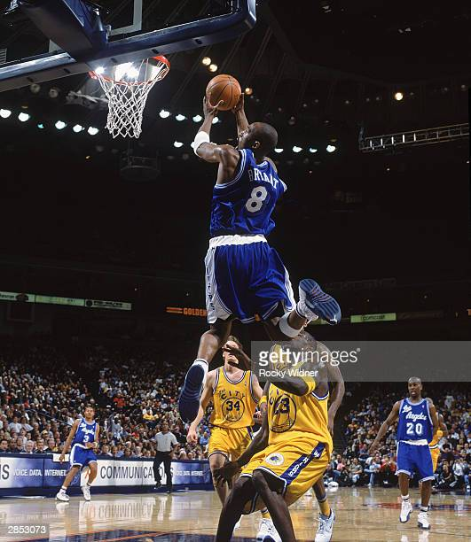 Kobe Bryant of the Los Angeles Lakers goes up for the slam dunk against the Golden State Warriors during the game on December 23 2003 at the Arena in...