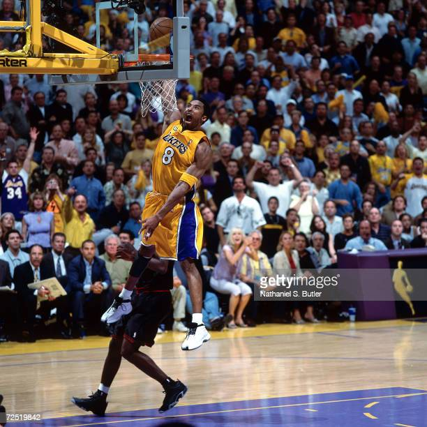 Kobe Bryant of the Los Angeles Lakers goes up hard for slam dunk against the Philadelphia 76ers during game 2 of the NBA Finals at Staples Center in...