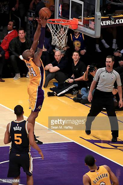 Kobe Bryant of the Los Angeles Lakers goes up to dunk the ball against the Utah Jazz at Staples Center on April 13 2016 in Los Angeles California...