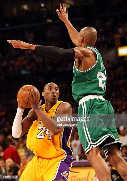Kobe Bryant of the Los Angeles Lakers goes up to shoot with Ray Allen of the Boston Celtics jumping in the air in Game Three of the 2008 NBA Finals...