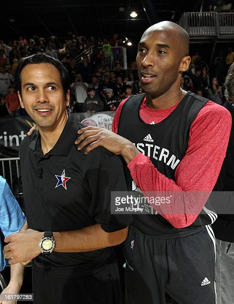 Kobe Bryant of the Los Angeles Lakers greets Erik Spoelstra head coach of the Miami Heat during the NBA AllStar Practice in Sprint Arena during the...