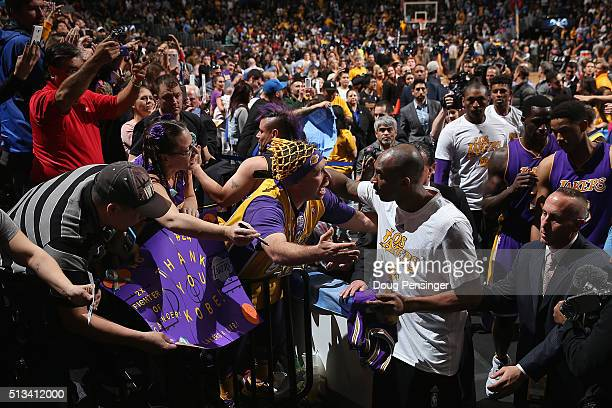 Kobe Bryant of the Los Angeles Lakers greets fans as he leaves the court after facing the Denver Nuggets at Pepsi Center on March 2 2016 in Denver...