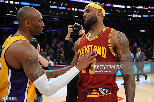 Kobe Bryant of the Los Angeles Lakers greets LeBron James of the Cleveland Cavaliers after the game on January 15 2015 at Staples Center in Los...