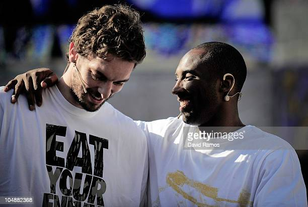 Kobe Bryant of the Los Angeles Lakers greets to his teammate Pau Gasol during the 'House of Hoops' contest by Foot Locker on October 6, 2010 in...