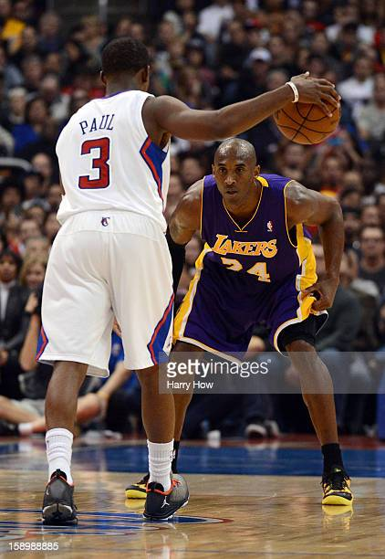 Kobe Bryant of the Los Angeles Lakers guards Chris Paul of the Los Angeles Clippers at Staples Center on January 4 2013 in Los Angeles California...