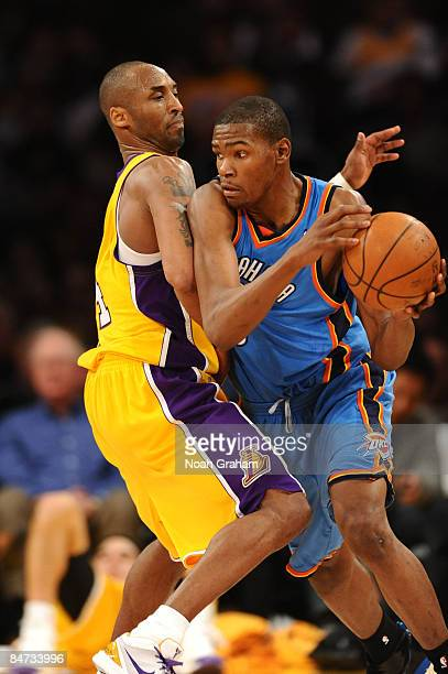 Kobe Bryant of the Los Angeles Lakers guards Kevin Durant of the Oklahoma City Thunder at Staples Center on February 10 2009 in Los Angeles...