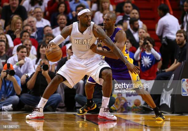 Kobe Bryant of the Los Angeles Lakers guards LeBron James of the Miami Heat during a game at American Airlines Arena on February 10 2013 in Miami...