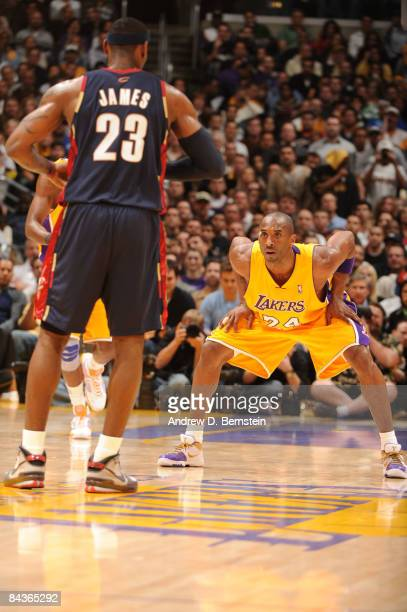 Kobe Bryant of the Los Angeles Lakers guards LeBron James of the Cleveland Cavaliers at Staples Center on January 19 2009 in Los Angeles California...