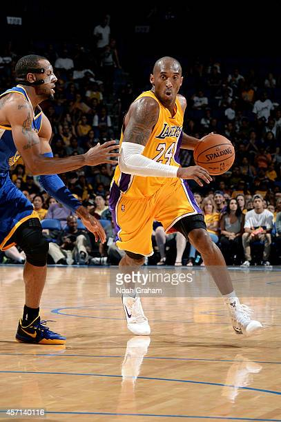 Kobe Bryant of the Los Angeles Lakers handles the ball against Andre Iguodala of the Golden State Warriors on October 12 2014 at Citizens Business...