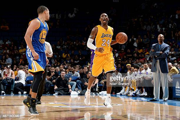 Kobe Bryant of the Los Angeles Lakers handles the ball against Stephen Curry of the Golden State Warriors on October 12 2014 at Citizens Business...
