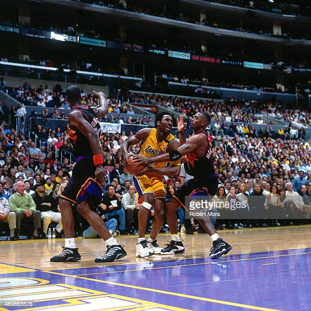 Kobe Bryant of the Los Angeles Lakers handles the ball against Anfernee Hardaway of the Phoenix Suns on May 16 2000 at Staples Center in Los Angeles...
