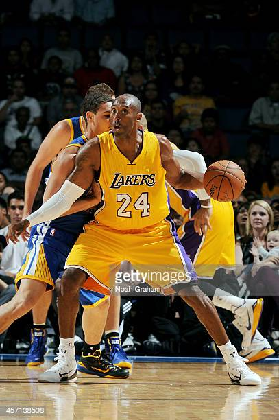 Kobe Bryant of the Los Angeles Lakers handles the ball during the game against the Golden State Warriors on October 12 2014 at Citizens Business Bank...