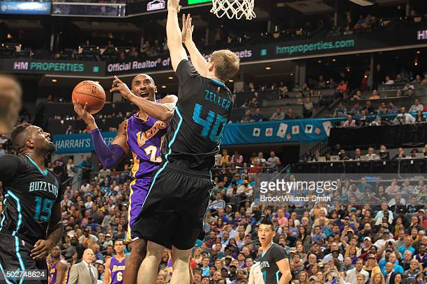 Kobe Bryant of the Los Angeles Lakers handles the ball during the game against the Charlotte Hornets on December 28 2015 at Time Warner Cable Arena...