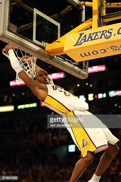 Kobe Bryant of the Los Angeles Lakers has a break away slam dunk in the final minute of Game Five of the 2008 NBA Finals against the Boston Celtics...