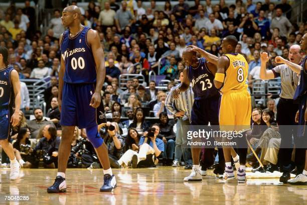 Kobe Bryant of the Los Angeles Lakers has a laugh with Michael Jordan of the Washington Wizards during a 2003 NBA game at the Staples Center in Los...