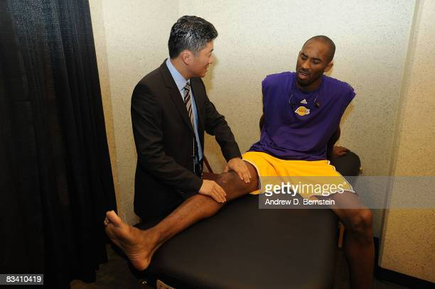 Kobe Bryant of the Los Angeles Lakers has his knee checked before a game against the Charlotte Bobcats on October 23 2008 at Honda Center in Anaheim...